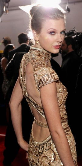 Love the neckline, back cut-outs, and embellishments.