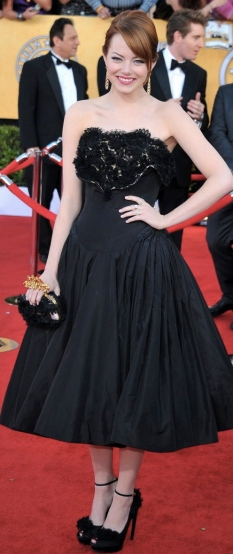 Emma Stone goes retro in tea length Alexander McQueen. Fabulous shoes, flawless updo + fun neckline, but I only wish it wasn't in black!